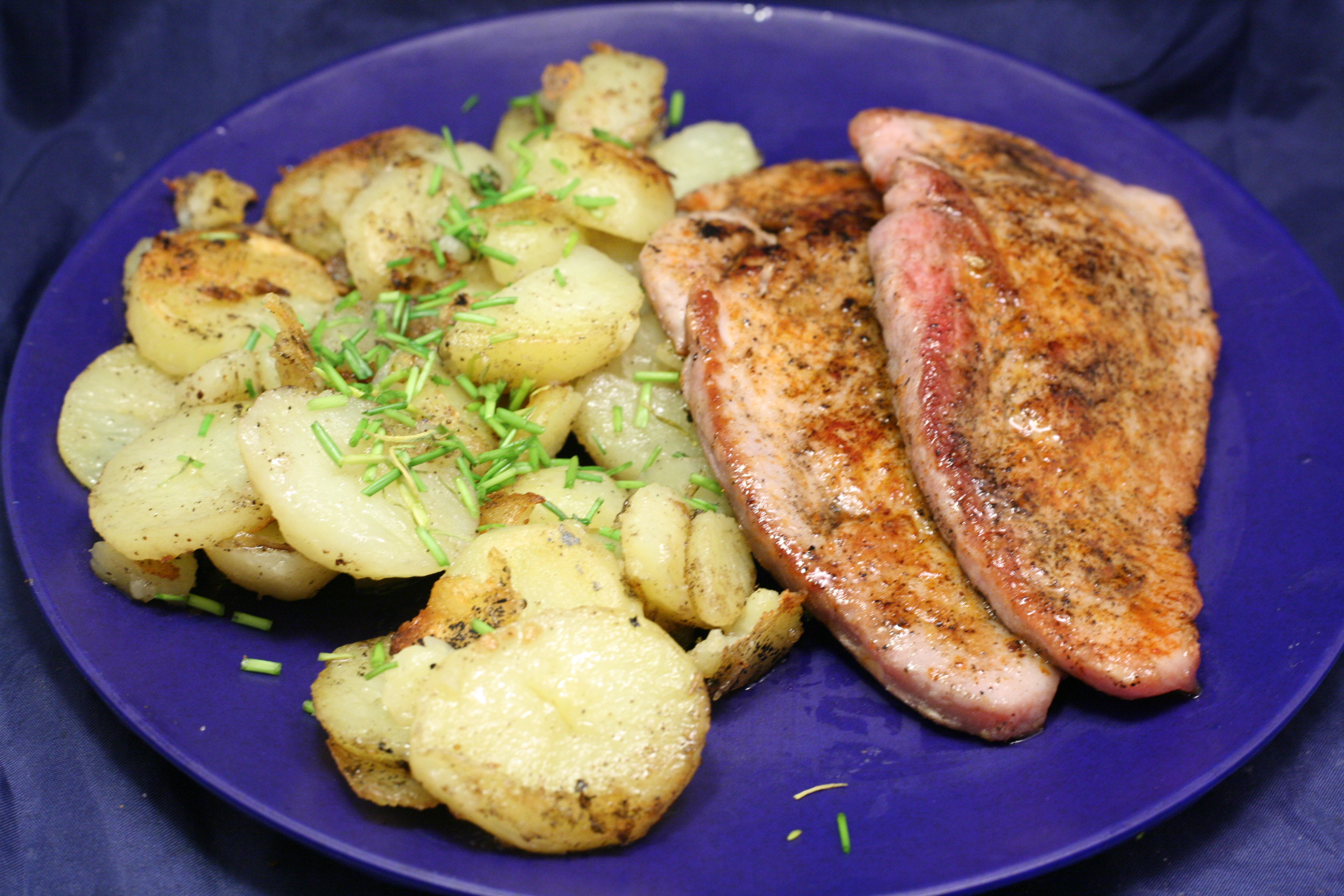 Schweine-Schnitzel mit Bratkartoffeln